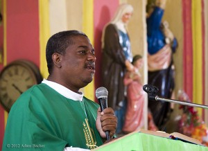 Father Jacques Judes Pierre Junior, at Sunday mass in Parish Saint Pierre, Baladeres, Haiti