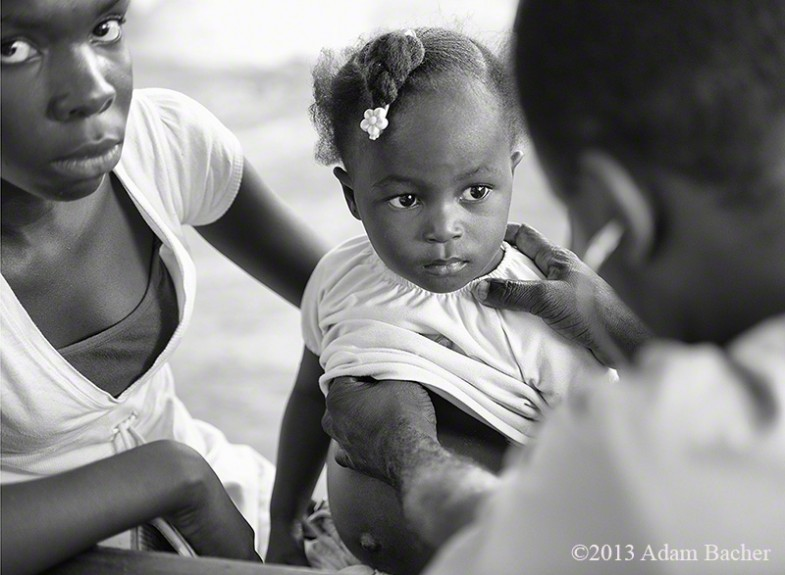 Mother and child being examined by a doctor, Dondon, Haiti, Mobile Healthcare Clinic