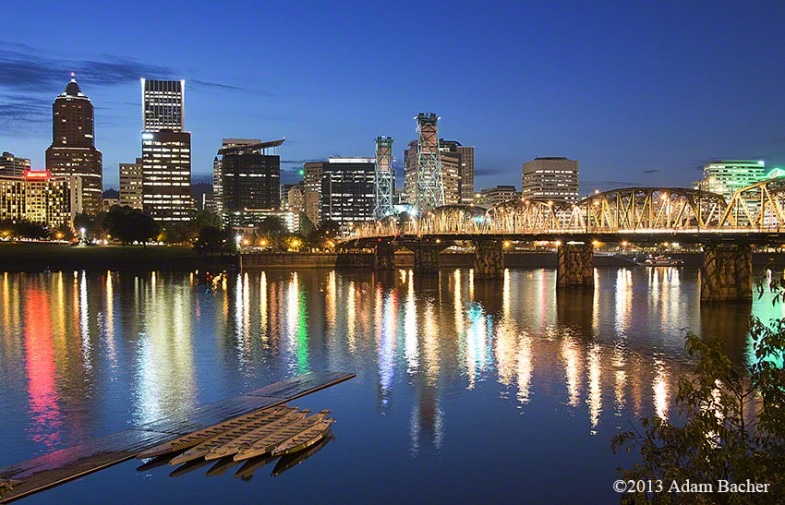Portland Oregon skyline at night with skulling boats and wilamet
