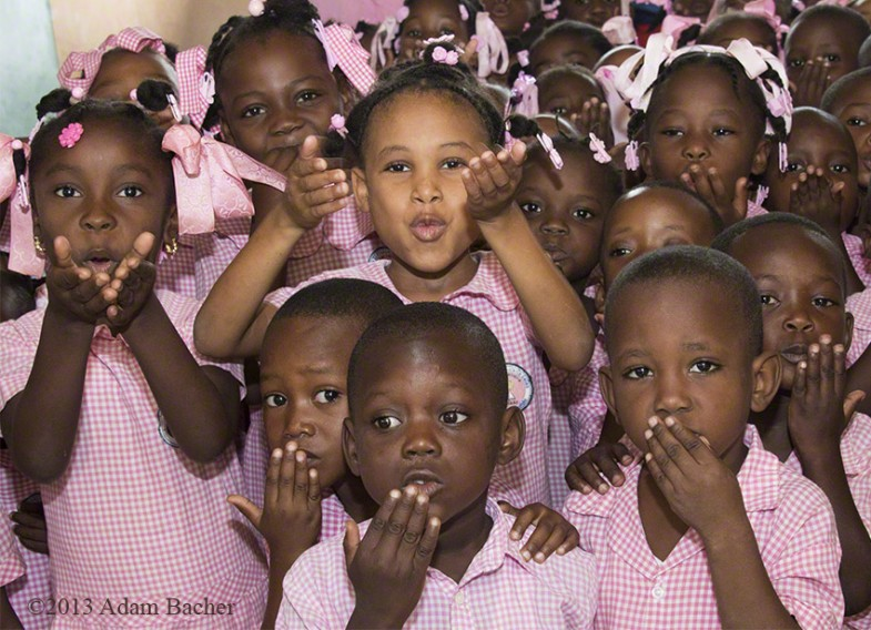 School children in Haiti blowing a kiss