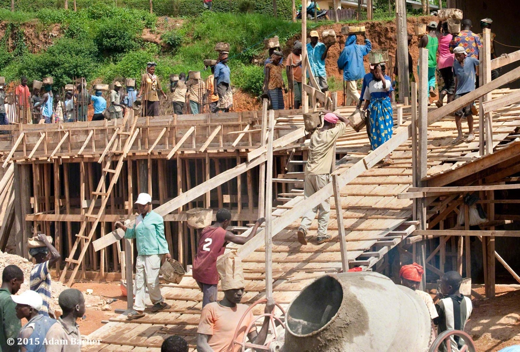 portland oregon editorial photographer in rwanda -workers building kigali parents secondary school