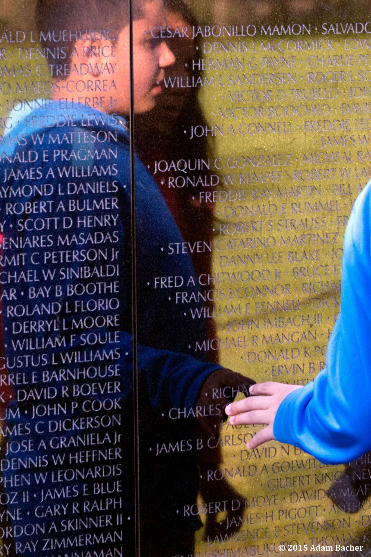 portland oregon editorial photographer at vietnam war memorial, washington D.C.