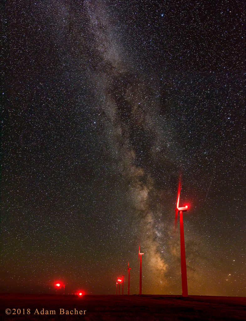 Wind turbines under the milky way and stars in Oregon.