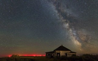 haunted sky - milky way and abandoned home in eastern oregon